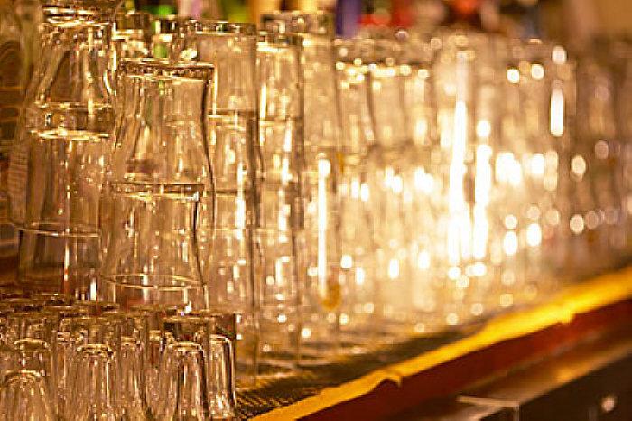 Rows of beer glasses in bar uid 1273376