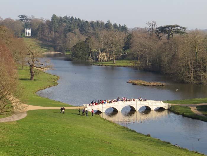 The lake at Painshill, showing the bridge and Gothic Temple.